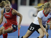 Germany`s Anke Brockmann (27) steals the ball from the United States` Katie O`Donnell (16) during the women`s hockey preliminary match at the 2012 Summer Olympics.