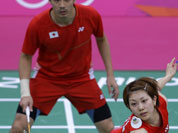 Japan`s Reiko Shiota, right, and Shintaro Ikeda, play against Canada`s Toby NG and Grace Gao, unseen, at a mixed doubles badminton match of the 2012 Summer Olympics.