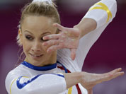 The hand of Romania`s gymnast Sandra Raluca Izbasa show calluses as she performs on the floor during the Artistic Gymnastics women`s qualification at the 2012 Summer Olympics.