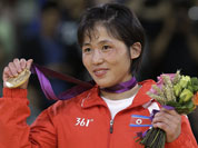 North Korea`s An Kum Ae holds her gold medal in the women`s 52-kg judo competition at the 2012 Summer Olympics.