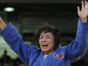 North Korea`s An Kum Ae celebrates after defeating Cuba`s Acosta Bermoy in the gold medal match in the women`s 52-kg judo competition at the 2012 Summer Olympics.