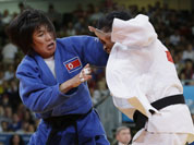 North Korea`s An Kum Ae, left, competes with Cuba`s Acosta Bermoy during the gold medal match in the women`s 52-kg judo competition at the 2012 Summer Olympics.