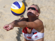 Lenka Hajeckova from Czech Republic reaches for a ball during the Beach Volleyball match against Mauritius at the 2012 Summer Olympics.