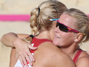 Lenka Hajeckova, right, from Czech Republic celebrates with her teammate Hana Klapalova, left, after defeating Mauritius in their Beach Volleyball match at the 2012 Summer Olympics.