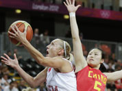 Croatia`s Andja Jelavic, left, drives to the basket against Song Xiaoyun during a women`s basketball game at the 2012 Summer Olympics.