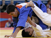 Ki Chun Wang of South Korea competes with Rinat Ibragimov of Kazakhstan, top, during the men`s 73-kg judo competition at the 2012 Summer Olympics in London.