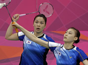 South Korea`s Jung Kyung-eun, left, and Kim Ha-na play against Valeria Sorokina and Nina Vislova, or Russia, during a women`s doubles badminton match at the 2012 Summer Olympics in London.