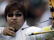 South Korea`s Im Dung-hyun shoots during an elimination round of the individual archery competition at the 2012 Summer Olympics in London.