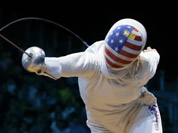 USA`s Courtney Hurley faces France`s Laura Flessel-Colovic during a women`s individual epee fencing round of 32 match at the 2012 Summer Olympics in London.