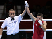 Algeria`s Samir Brahimi,  reacts after defeating Australia`s Jackson Woods in their men`s flyweight 52-kg boxing match at the 2012 Summer Olympics in London.