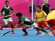 Pakistan`s Waseem Ahmad, and Spain`s David Alegre vie for the ball during their men`s field hockey preliminary-round match at the 2012 Summer Olympics in London.