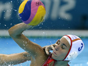 Ma Huanhuan of China, attempts to block a shot by Anna Espar Llaquet of Spain during their women`s water polo preliminary round match at the 2012 Summer Olympics in London.