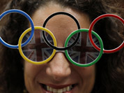 Dana Kerstein wears glasses with the Olympic rings as she attends the archery competition at the 2012 Summer Olympics in London.