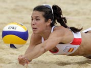 Elsa Baquerizo of Spain dives for a ball during a beach volleyball match against Argentina at the 2012 Summer Olympics.