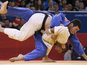 Travis Stevens of the United States competes with Avtandil Tchrikishvili of Georgia, top, during the men`s 81-kg judo competition at the 2012 Summer Olympics.