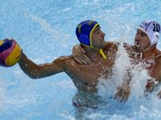 Peter Biros, right, of Hungary defends against Mladan Janovic of Montenegro during a preliminary men`s water polo match at the 2012 Summer Olympics.
