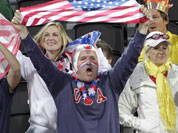 Fans cheer for the United States during a beach volleyball match against the Czech Republic at the 2012 Summer Olympics in London.