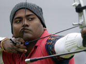 Jayanta Talukdar shoots during an elimination round of the individual archery competition at the 2012 Summer Olympics in London.