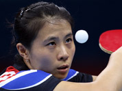 Kim Kyungah of South Korea competes against Tianwei Feng of Singapore during the women`s singles table tennis competition at the 2012 Summer Olympics in London.