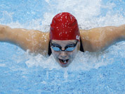 Britain`s Ellen Gandy competes in a women`s 200-meter butterfly swimming heatat the Aquatics Centre in the Olympic Park during the 2012 Summer Olympics, London.