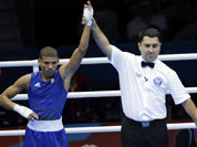 Cuba`s Yosbany Veitia Soto, reacts after defeating Australia`s Billy Ward during a light flyweight 49-kg preliminary boxing match at the 2012 Summer Olympics in London.