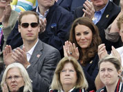Britain`s Prince William, his wife Kate Middleton the Duchess of Cambridge, and Prince Harry,  watch the show-jumping phase of the equestrian eventing competition at the 2012 Summer Olympics at Greenwich Park in London.