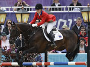 Nina Lamsam Ligon of Thailand rides her horse Butts Leon in the show-jumping phase of the equestrian eventing competition at the 2012 Summer Olympics, at Greenwich Park in London.