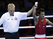 Devendro Singh Laishram, reacts after defeating Honduras` Bayron Molina Figueroa during a light flyweight 49-kg preliminary boxing match at the 2012 Summer Olympics in London.
