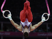 US gymnast Jacob Dalton performs on the rings during the Artistic Gymnastic men`s team final at the 2012 Summer Olympics.