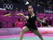 India`s Saina Nehwal plays against Belgium`s Lianne Tan, unseen, at a woman`s singles badminton match of the 2012 Summer Olympics.