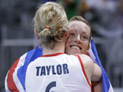 Britain`s Jennifer Taylor (6) and teammate Lynne Beattie hug after their team defeated Algeria in a women`s preliminary volleyball match at the 2012 Summer Olympics.