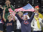 Fans cheer for the United States during a beach volleyball match against the Czech Republic at the 2012 Summer Olympics.
