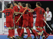 Belgian players celebrate their goal against Germany during their men`s hockey preliminary match at the 2012 Summer Olympics.