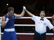Germany`s Enrico Kolling, left, reacts after defeating Cameroon`s Christian Donfack Adjoufack in a men`s light heavy 81-kg boxing match at the 2012 Summer Olympics.