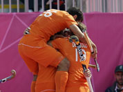 The Netherlands` Valentin Verga (26) jumps on top of his teammates, including Roderick Weusthof, shortly after scoring a goal in the men`s hockey preliminary match against India at the 2012 Summer Olympics.