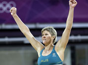 Nat Cook of Australia reacts to the crowd in a contest against Austria during a beach volleyball match at the 2012 Summer Olympics.