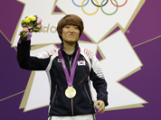 South Korea`s Kim Jangmi reacts after firing her final shots and realizing she has won gold in the women`s 25-meter pistol event, at the 2012 Summer Olympics.