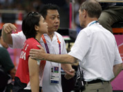 Head badminton referee Torsten Berg talks to Indonesia`s Greysia Polii and her coach Paulus Firman, after he showed a black card to players in the women`s doubles badminton match in London.