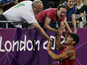 Alexander Horst of Austria reacts with fans at the end of a beach volleyball match win against Italy at the 2012 Summer Olympics in London.