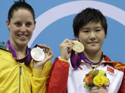 Australia`s Alicia Coutts, left, China`s Ye Shiwen, center, and the United States` Caitlin Leverenz pose with their medals for the women`s 200-meter individual medley swimming final pose at the Aquatics Centre in the Olympic Park during the 2012 Summer Olympics in London.
