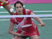 India`s Ashwini Ponappa, left, and Jwala Gutta, play against Singapore`s Sari Shinta Mulia and Yao Lei, unseen, at a women`s doubles badminton match of the 2012 Summer Olympics in London.