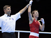Australia`s Jeffrey Horn, right, reacts after defeating Zambia`s Gilbert Choombe in a men`s light welter 64-kg boxing match at the 2012 Summer Olympics in London.