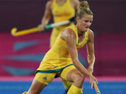 Australia`s Kobie McGurk, right, and Germany`s Christina Schuetze vie for the ball during their women`s hockey preliminary round match at the 2012 Summer Olympics in London.