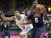 USA`s Lebron James (6) looks to pass as he is pressured by Tunisia`s Mohamed Hadidane during a men`s basketball game at the 2012 Summer Olympics in London.
