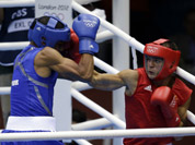 Sweden`s Anthony Yigit, right, fights Puerto Rico`s Francisco Vargas Ramirez during a light welterweight 64-kg preliminary boxing match at the 2012 Summer Olympics in London.