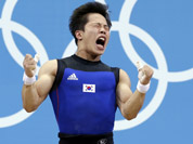 Won Jeongsik of South Korea reacts while competing during the men`s 69-kg, group A, weightlifting competition at the 2012 Summer Olympics in London.