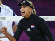 April Ross, left, of US and Marleen Van Iersel, right, from Netherlands react during the Beach Volleyball match against Netherlands at the 2012 Summer Olympics in London.