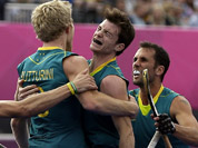 Australia`s Matthew Butturini (8) celebrates his goal with teammates during their men`s hockey preliminary match against Spain at the 2012 Summer Olympics in London. Australia won 5-0.