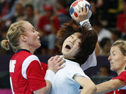 South Korea`s Jo Hyo-bi, center is tackled by Norway`s Karoline Dyhre Breivang, left, and Lynn-Kristin Koren, right, during their women`s handball preliminary match at the 2012 Summer Olympics in London.