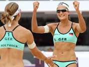 Katrin Holtwick, left, from Germany celebrates with her teammate Illka Semmler, right, after defeating Mauritius in their Beach Volleyball match at the 2012 Summer Olympics in London. 